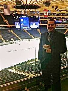 Spencer reporting for 88.7 FM WRHU at Madison Square Garden following a Rangers-Islanders NHL regular season game in 2012.